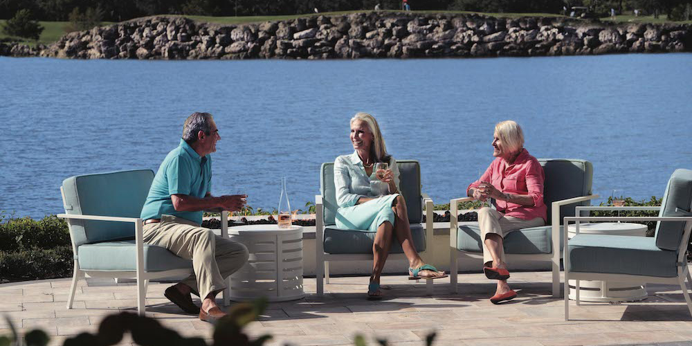 residents enjoying waterfront cocktails at Moorings Park in Naples, Florida