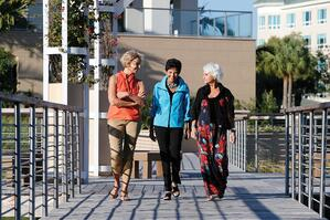 Residents enjoy a picturesque walk around Moorings Park.