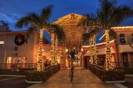 bigstock-Christmas-Lights-Glow-At-Sunse-267538816