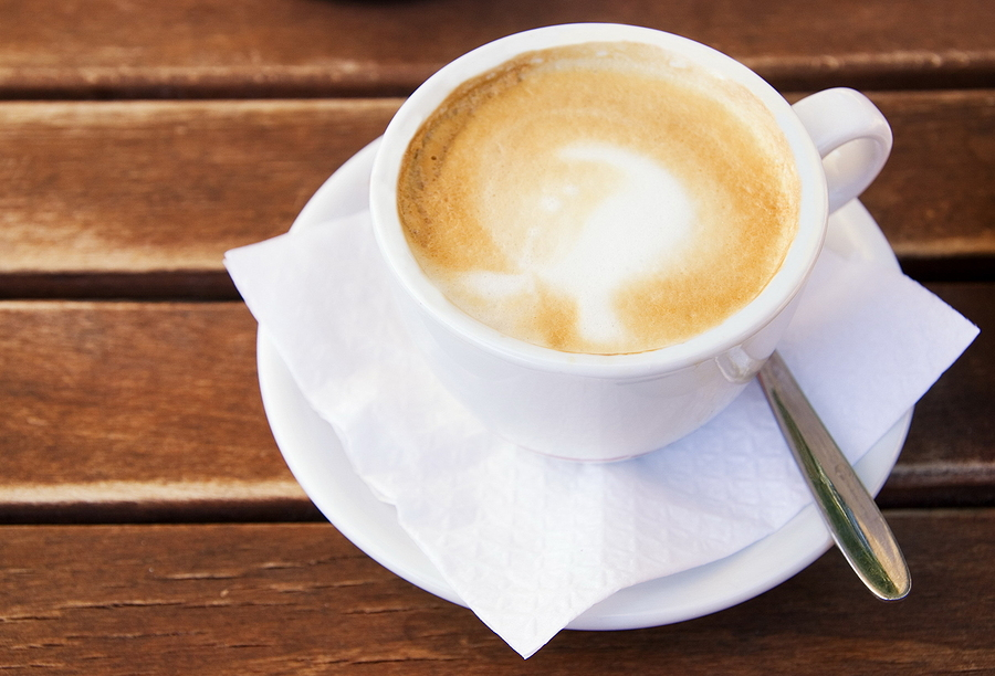 bigstock-Coffee-cup-on-wooden-table-13193966