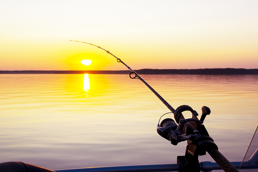 bigstock-Fishing-Rod-Spinning-With-The--314426968