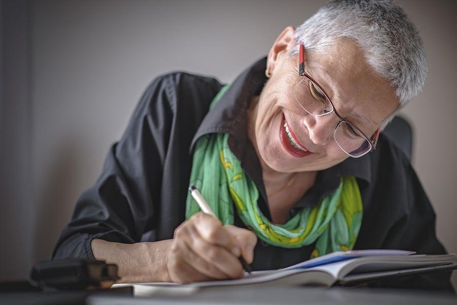 bigstock-Senior-Old-Woman-Writing-Down--226829248