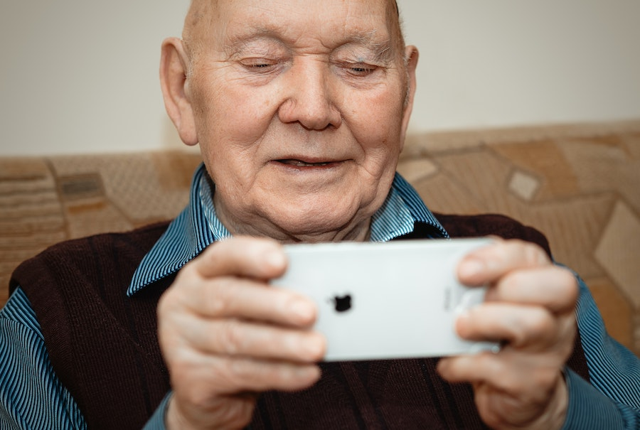 elderly man using iphone
