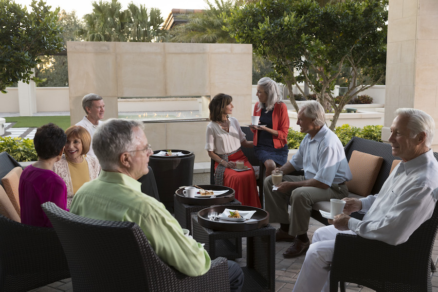 residents eating together outside at Moorings Park in Naples, Florida